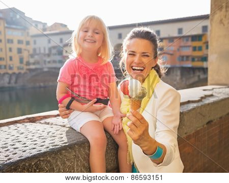 Closeup On Smiling Mother And Baby Girl Showing Ice Cream Near P