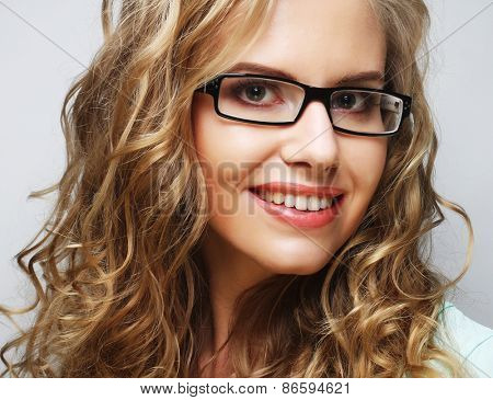 calm and friendly blond woman with glasses