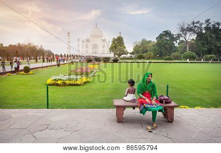 Indian Woman With Daughter Near Taj Mahal