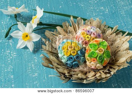 Colorful Easter Eggs In A Basket And Daffodils