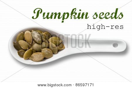 Peeled Pumpkin Seeds In White Porcelain Spoon / High Resolution Product Photography Of Seed In White