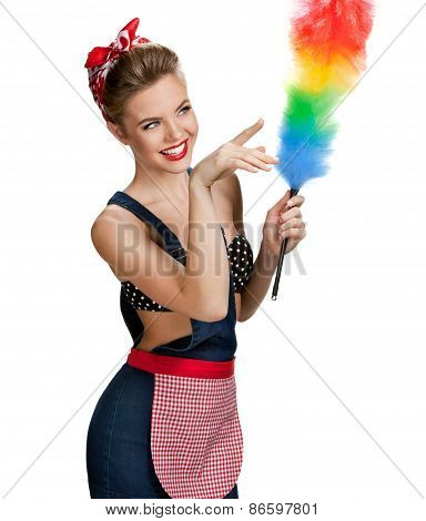 Young Beautiful Cleaning Woman Holding Static Duster And Pointing To The Right / Young Beautiful
