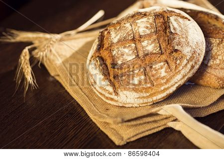 Rustic Bread And Wheat On A Traditional Cloth Bag