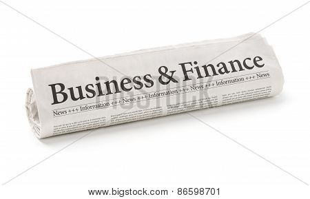 Rolled Newspaper With The Headline Business And Finance