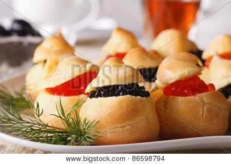 Tasty Snack: Profiteroles Stuffed With Red And Black Caviar