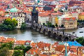 stock photo of old bridge  - Tourism and sightseeing view from above over famous sight of Prague Charles Bridge and Old Town Eastern tower - JPG