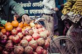 stock photo of nepali  - The hawker sell his fruits in Thamel in Katmandu Nepal - JPG