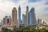 stock photo of dubai  - Dubai Marina Skyscrapers. Dubai United Arab Emirates ** Note: Visible grain at 100%, best at smaller sizes - JPG