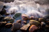 picture of granite  - Beautiful granite stones into the Baltic sea at sunset - JPG