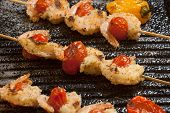 picture of crust  - Grilled Parmesan crust shrimp with chery tomatoes on the grill with grilled mini bell peppers - JPG