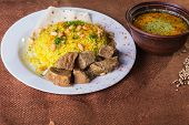 stock photo of arabic  - Pilaf cooked in Arabic - JPG