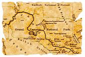 stock photo of grand canyon  - Grand Canyon National Park on an old torn map from 1949 isolated - JPG