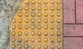 stock photo of paved road  - image of close up at Tactile paving texture for blind handicap on the road - JPG