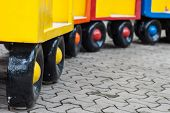 stock photo of train-wheel  - colorful of wheel train on the cement floor - JPG