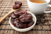 stock photo of dry fruit  - closeup sweet dried dates fruit with tea - JPG