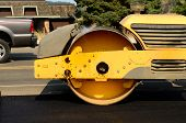stock photo of paving  - Drum tandem vibratory rollers compacting down a fresh layer of paving on a new road interchange project - JPG