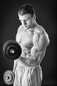 foto of dumbbell  - Man makes exercises dumbbells - JPG