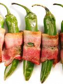 pic of jalapeno  - Grilled jalapenos wrapped in bacon isolated on white - JPG