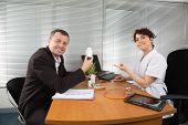 pic of prophylactic  - Businessman with Female Doctor at her office - JPG