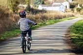 picture of excite  - Riding a bicycle on a country road concept for healthy lifestyle - JPG