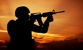 picture of army soldier  - Soldier shooting with his weapon - JPG