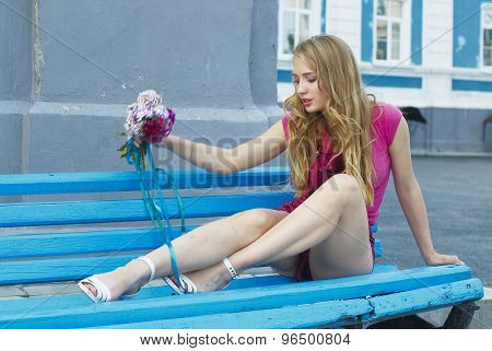 Attractive waiting girl with bouquet
