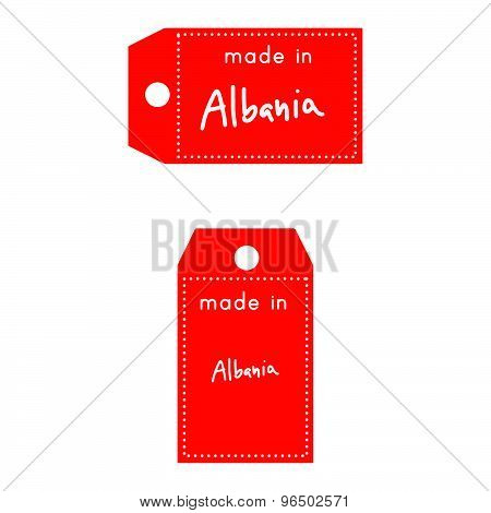 Red Price Tag Or Label With White Word Made In Albania Isolated On White Background