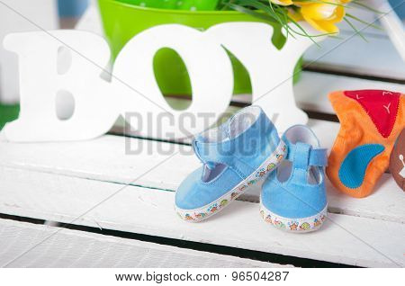 Blue baby shoes and flowers