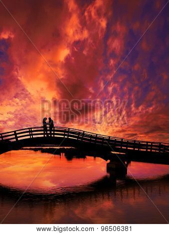 Couple enjoying the romantic sunset on the Lefkas town bridge in Greece