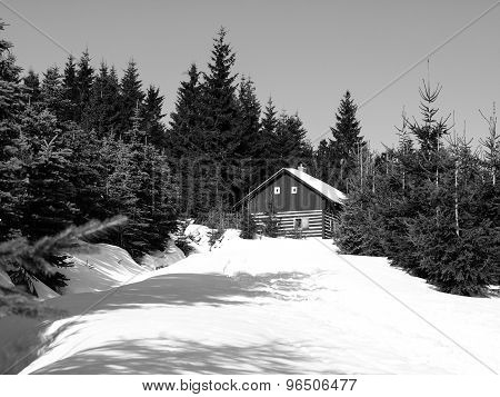 Small mountain hut in winter time
