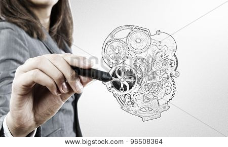 Close up of female hand drawing mechanical heart