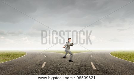 Cheerful young businessman demonstrating self defence element