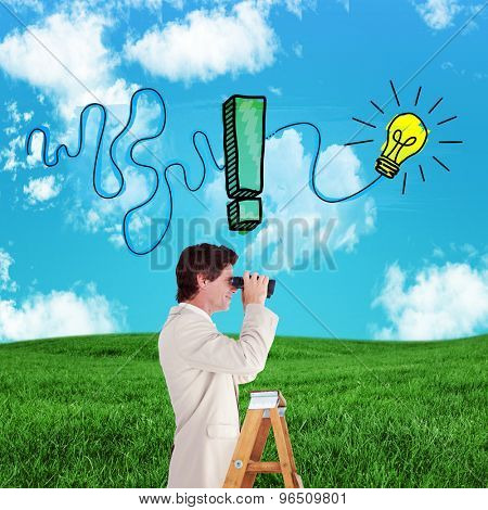 Businessman looking on a ladder against green field under blue sky