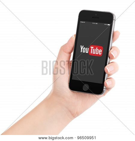 Female Hand Holding Black Apple Iphone 5S With Youtube App Logo On The Display