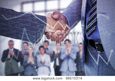Businessman shaking hands with a co worker against stocks and shares