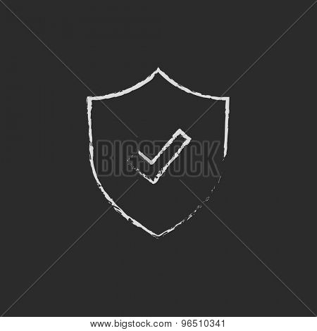 Shield with check mark hand drawn in chalk on a blackboard vector white icon on a black background