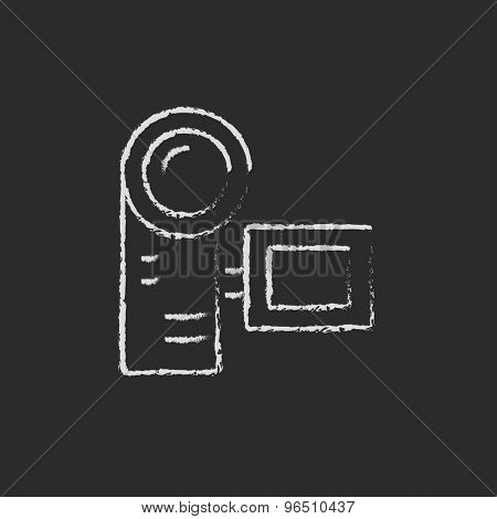 Camcorder hand drawn in chalk on a blackboard vector white icon on a black background