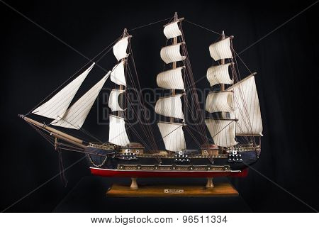 Highly detailed XVIII century frigate model isolated over black background