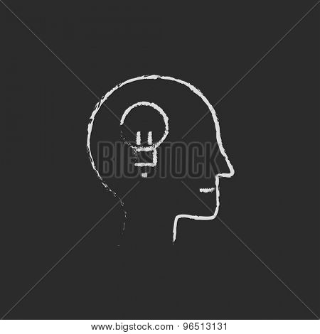 Human head with idea hand drawn in chalk on a blackboard vector white icon on a black background
