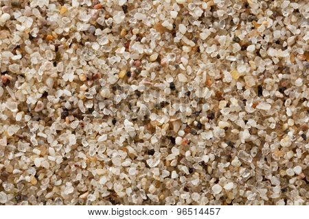 quartz sand grain at 4 times life-size magnification, a sample from Great Sand Dunes National Park, Colorado