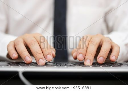 Closeup Of Businessman Hands Typing On Computer Keyboard
