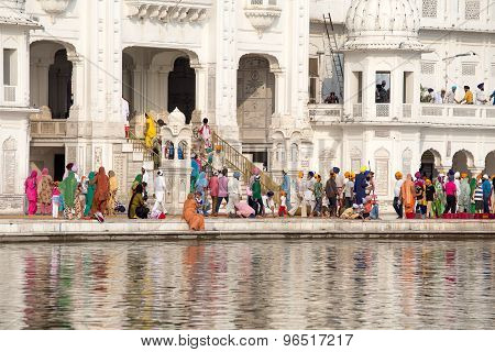 Sikh And Indian People Visiting The Golden Temple In Amritsar, Punjab, India.