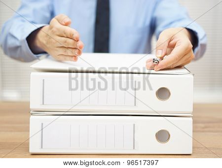 Business Partner Proposed Cooperation And Signing A Contract Over A Lot Of Folders