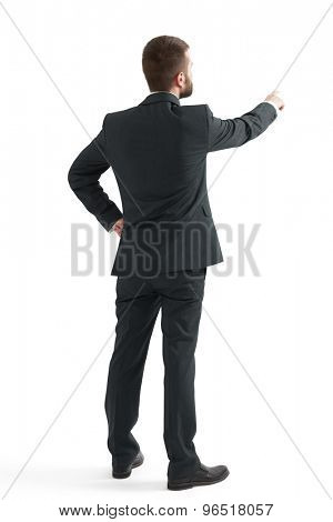 back view of businessman in formal wear pointing finger at something. isolated on white background