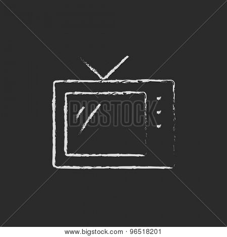 Retro television hand drawn in chalk on a blackboard vector white icon on a black background