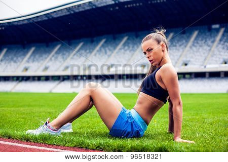 Fitness woman on stadium doing exercise