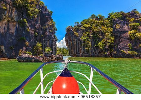 A boat trip with a red lantern. The holiday in Thailand. Bay in the Andaman Sea and exotic island
