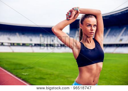 Fitness woman on stadium stretching