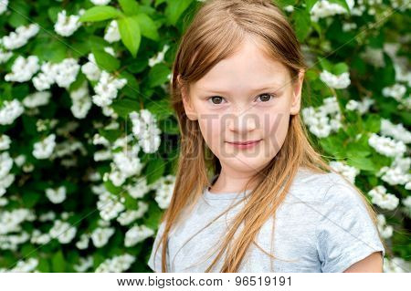 Close up portrait of a cute little girl of 7 years old