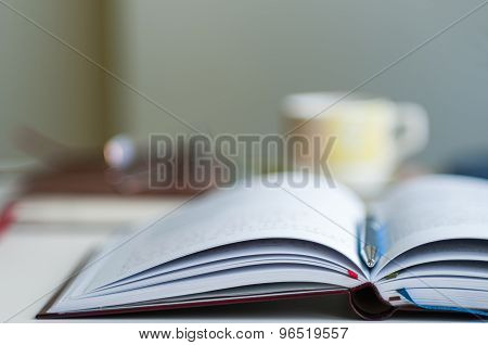 Open Notebook Blurred Background